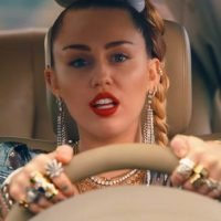 Watch Miley Cyrus' Wild Attempt to Escape Police in 'Nothing Breaks Like a Heart' Music Video