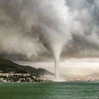 Terrifying 'waterspout' forms under darkened sky sending huge column into air