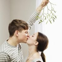Why do people kiss under mistletoe at Christmas, what colour are its berries and where is the plant from?
