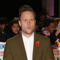 Olly Murs says he'd like to find love among The Voice stars but fears the sack