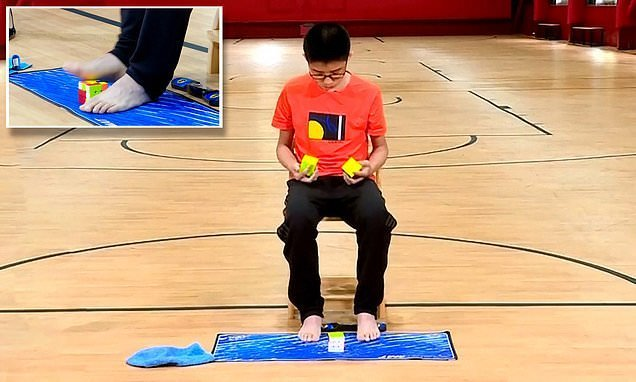 Teen solves three Rubik's cubes with his hands and feet simultaneously