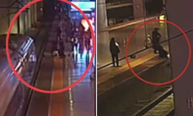 Woman jumps onto train tracks to SCARE boyfriend during fight