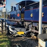 Mercedes is crushed beneath a steam train at 8mph on a level crossing