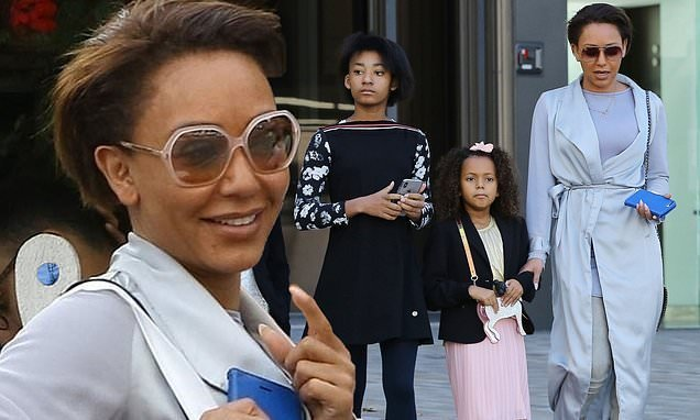 Mel B looks chic in silky coat during church outing with her children