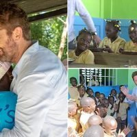 Gerard Butler shares a meal with school children in Haiti
