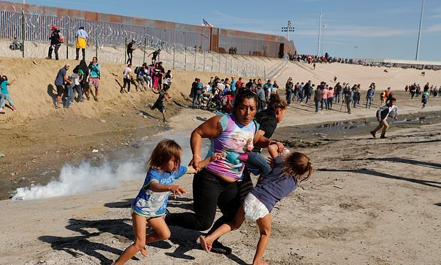 US agents fire tear gas and rubber bullets at hundreds of migrants