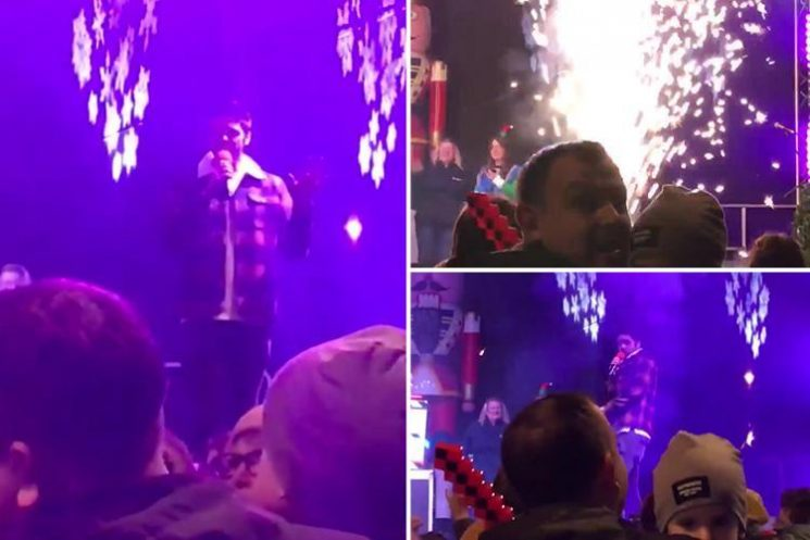 X Factor winner Ben Haenow narrowly avoids being set on fire as pyrotechnics explode during Christmas lights switch on