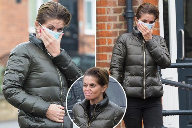 Danniella Westbrook covers face with a mask outside clinic amid reports she's planning surgery to fix cheekbone which has 'rotted away'
