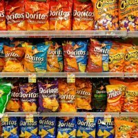 High street stores should 'move junk food away from the checkouts' so it is harder to find, experts claim