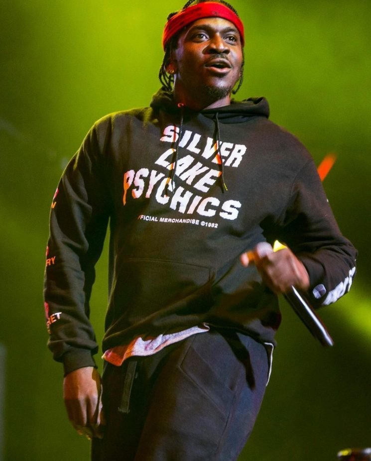 Dramatic moment mass brawl erupts during Pusha T gig as 'Drake fans' storm stage in latest bust-up in rappers' rivalry