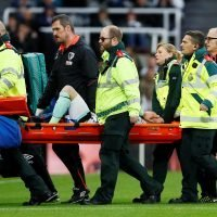 Bournemouth's Adam Smith stretchered off with horror knee injury against Newcastle