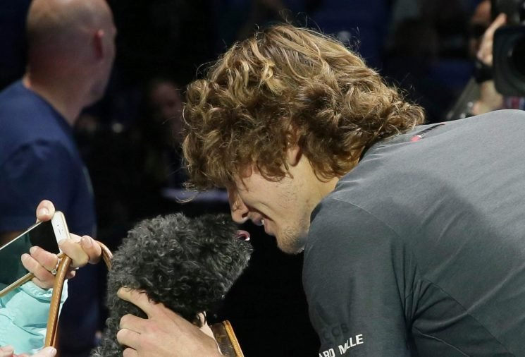 Alexander Zverev has Becks Appeal as he beats Novak Djokovic to become ATP Finals champ and celebrates with puppy that his mum held in a bag