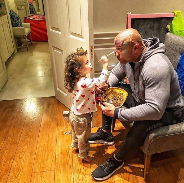 The Rock melts fans' hearts with adorable pic of daughter Jazzy painting his face before he heads to work