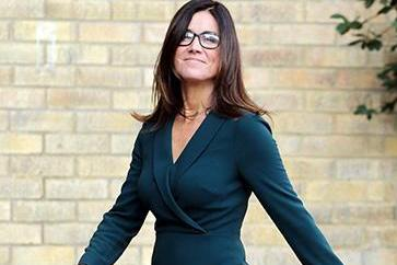 Susanna Reid looks incredible in a dark green dress after revealing one stone weight loss