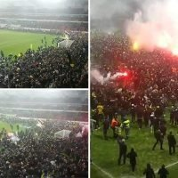 AIK fans celebrate title win with incredible pitch invasion and fireworks display