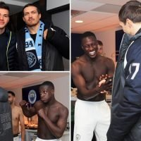 Benjamin Mendy pretends to punch Oleksandr Usyk as cruiserweight champ celebrates in City locker room after derby win over Manchester United