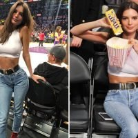 Emily Ratajkowski shows off her toned midriff as she eats popcorn and sweets courtside at NBA game