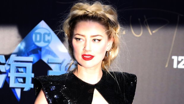 Amber Heard Risks Wardrobe Malfunction With Cut-Out Mini Dress – See Her Bold Look