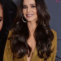 Cheryl wears plunging gold suit and tiny bra at hair extensions launch