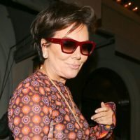 Kris Jenner Trips & Falls During On-Stage Appearance After Finally Taking Off Her Sunglasses
