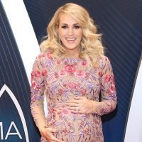 Bump Pretty! Pregnant Carrie Underwood Cradles Her Growing Belly on the CMA Awards Red Carpet