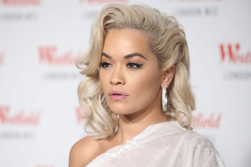 Rita Ora stuns in sheer feather gown at charity concert