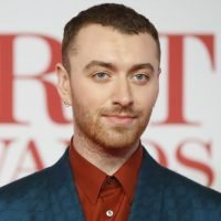 Sam Smith channels Gloria Estefan in a skirt and heels