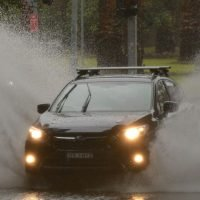 Sydney floods: One dead as month's worth of rain falls in single morning