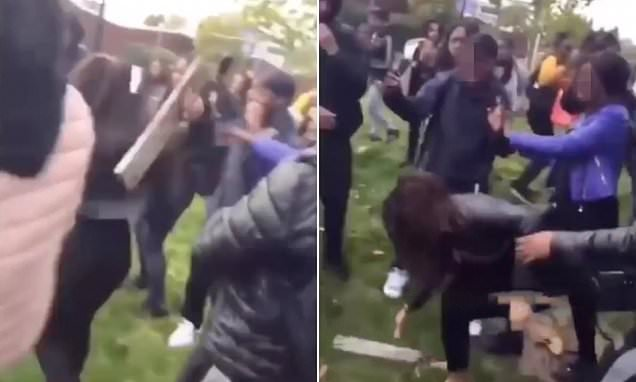 Students hit each other around head with WOOD outside college