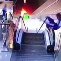 Boy falls from third-floor escalator after climbing onto the handrail