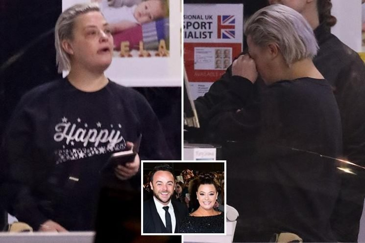 Lisa Armstrong looks tired as she steps out make-up free in London wearing a 'happy' jumper