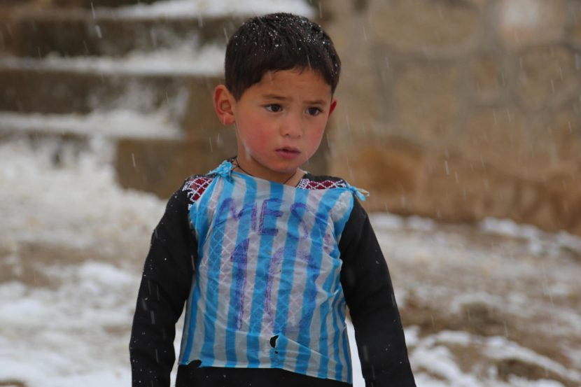 Afghan boy famous for wearing Lionel Messi plastic bag shirt forced to flee home after Taliban offensive