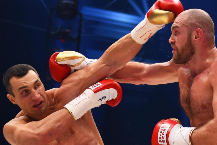 When did Tyson Fury lose his world titles, and how long did Gypsy King have out of the boxing ring?