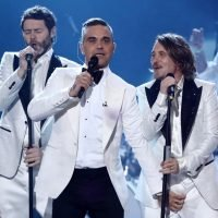 Robbie Williams caught grabbing Mark Owen's crotch live on stage during X Factor performance