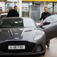 Kate Wright looks stylish in flared trousers on day out with fiance Rio Ferdinand in his Aston Martin after taking £2.5m off the price of the house he shared with late wife