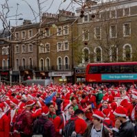 Hundreds of boozed-up Santas get into the Christmas spirit as they descend on London for pub crawl
