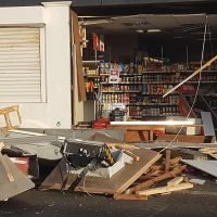 Raiders ripped off the entire front of a shop with a stolen dumper truck to 'steal a cash machine inside'