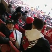 Mesut Ozil stuns kid wearing 'OZIL' cap as Arsenal ace sits next to him in stands for Huddersfield win