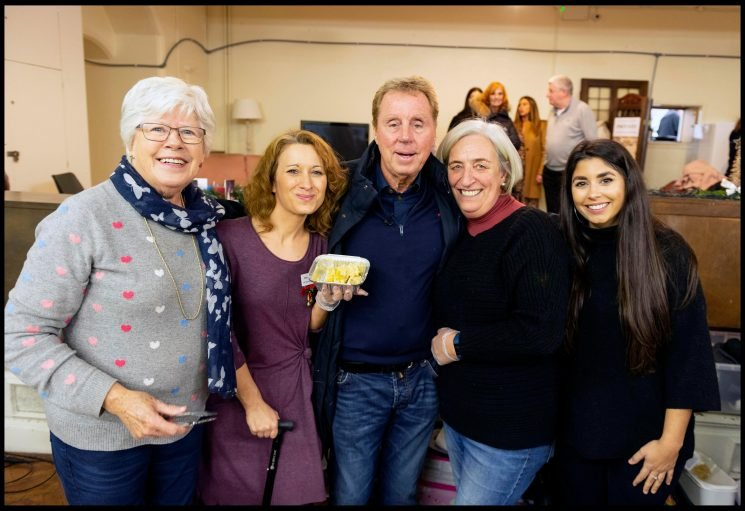 Harry Redknapp dishes out jam roly poly to the homeless after being inundated with his favourite pudding from I'm A Celeb fans