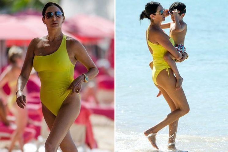 Lauren Silverman wows in bright yellow swimsuit as she plays on the beach in Barbados with son Eric