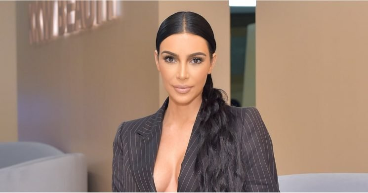 Kim Kardashian Is Making Sexy Business Casual a Thing With This Plunging Pinstripe Suit
