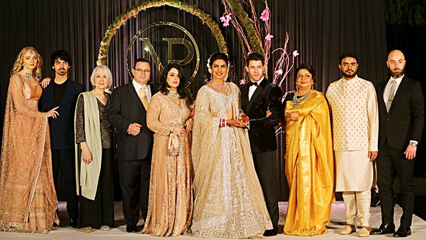 Priyanka Chopra & Nick Jonas Look Glowingly Happy With Both Families At Wedding Reception