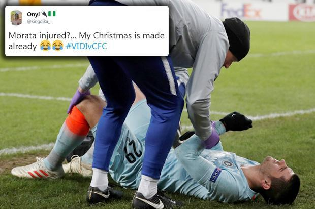 Alvaro Morata limps off for Chelsea in Europa League… and fans celebrate 'Christmas' coming early