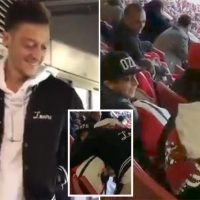 Mesut Ozil makes young Arsenal fan's day by sitting next to him in stands at Huddersfield win