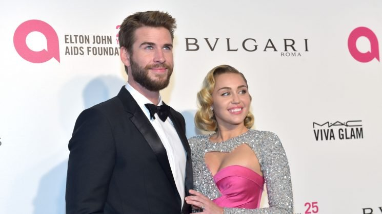 Miley Cyrus hints at marriage to Liam Hemsworth by sharing romantic photos in white dress