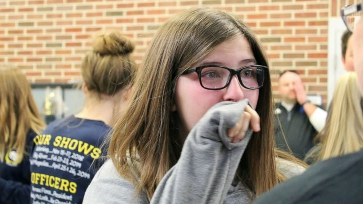 Teen left in tears as her classmates reveal she's cancer-free