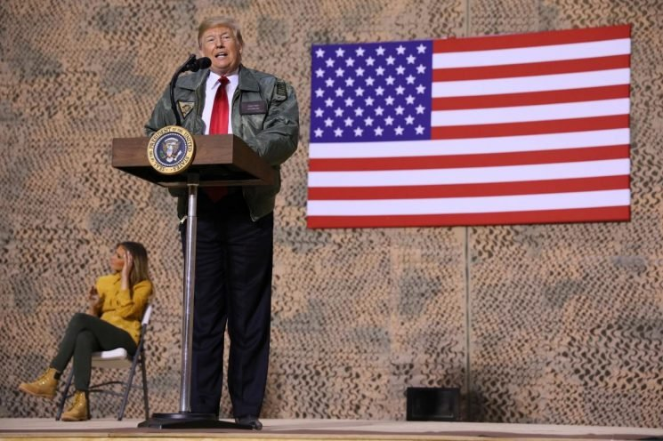 Trump defends Syria pullout during surprise visit to Iraq