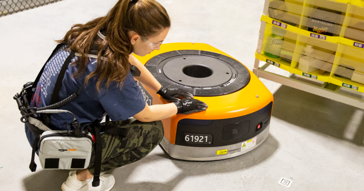 Amazon warehouse workers wear special belts to stop robots crashing into them