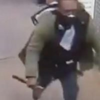Moment Tesco shoppers flee in terror as masked man with 'axe' goes on rampage