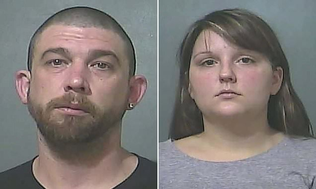 Child's tongue 'cut with scissors', couple arrested over injuries